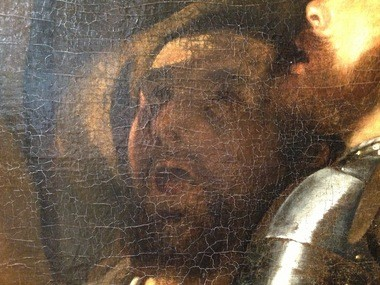 Cracks in the surface of the Cleveland Museum of Art's Caravaggio make the image hard to read.