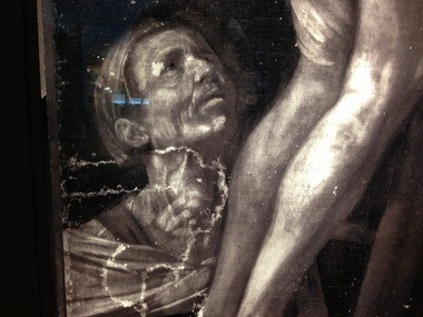 A detail of a large infrared image of the Cleveland Museum of Art's Caravaggio shows repaired rips in the canvas that cannot be seen with the naked eye.