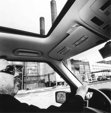 Lee Friedlander photographed Mark Schwartz at the wheel of his SUV in 2009 during a photo shoot in Cleveland's industrial Flats.
