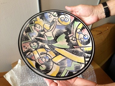 Albert Albano of ICA Art Conservation held a Viktor Schreckengost plate during a visit to Rhodes Tower at CSU on Tuesday.