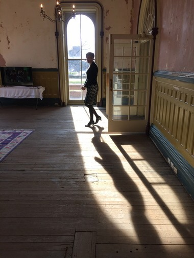 Maria Campanelli, director of the Children's Museum of Cleveland, casts a shadow in the parlor of the Stager-Beckwith Mansion, the future new home of the museum.