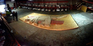 Laid out and ready to go: The Schreckengost mastodon and baby at a Cleveland warehouse on Wednesday. Items on shelves are wrapped pieces of the Schreckengost mammoth and infant.