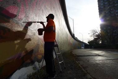 Adam Zimmerman at work on Ananda Nuha's Creative Fusion mural.