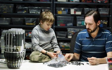 """Lego fanatic Adrian Drake, right, and his son, Ethan, piece together a second Lego edition of the Serenity ship from the television series """"Firefly."""" The model, which will entail some 70,000 bricks, is the builder's pride and joy."""