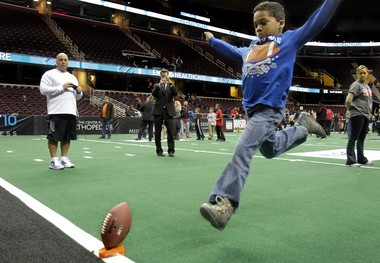 After the Cleveland Gladiators season opener, fans were invited on the field to try to kick a field goal. Its one of many initiatives the team uses to reach out to fans.