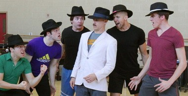 """Harry Bouvy as Nathan Detroit is intimidated by the other gambler guys during an April rehearsal of """"Guys and Dolls."""""""