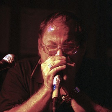 """Bill """"Mr. Stress"""" Miller plays a harmonica solo during jam night at Cebars in Cleveland on Sunday, July 27, 2002."""