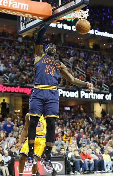 2431849e932 LeBron James dunks the basketball while wearing his limited edition BHM  shoes by Nike in a