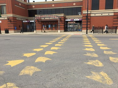 The Duck Crossing leads the way to Canal Park on Main Street in downtown Akron.