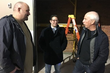 Luke Purcell, Julian Bruell and Zack Bruell inside Collision Bend Brewing Co. on the Flats East Bank in Cleveland.