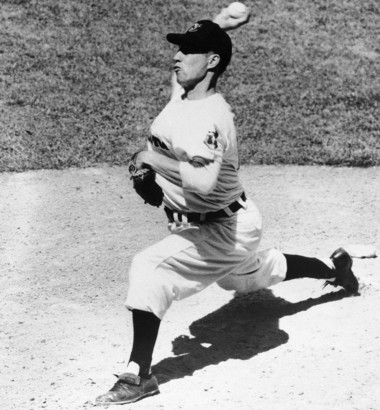 FILE - In this May 2, 1955, file photo, Cleveland Indians pitcher Bob Feller delivers a pitch during a baseball game in Cleveland, Ohio. (AP Photo)