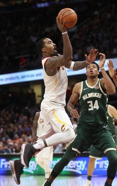 Cavaliers guard J.R. Smith drives through the lane pass Milwaukee Bucks forward Giannis Antetokounmpo at Quicken Loans Arena on Tuesday, Nov. 7, 2017.