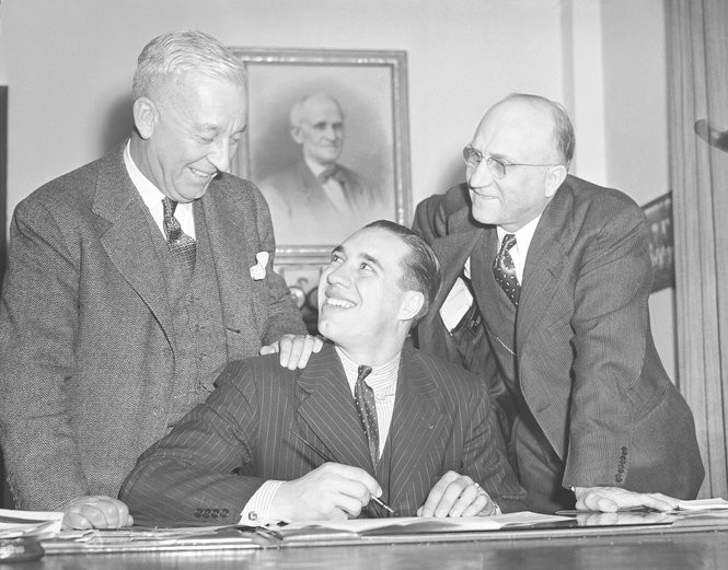 Indians president Alva Bradley, left, and Cy Slapnicka flank Bob Feller in 1941. Slapnicka signed Feller as well as Hugh Alexander, whom he would later mentor as a scout.