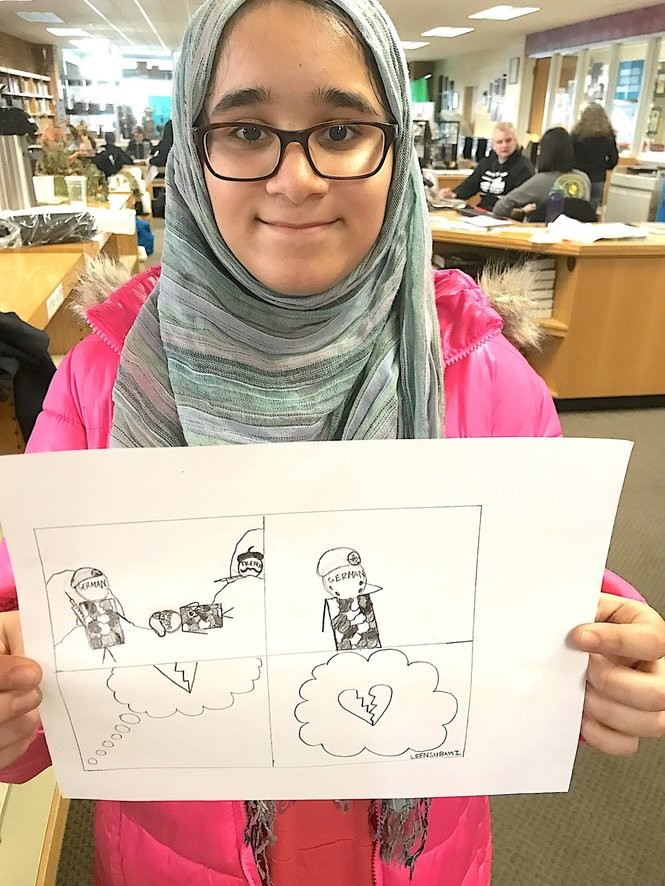 "Leen Subhai shows the political cartoon she created to tell the story of a battle between French and German forces as part of a Theodore Roosevelt High School study of trench warfare in World War I. The simple drawing captures the reality of war: No matter who ""wins,'' hearts are broken."