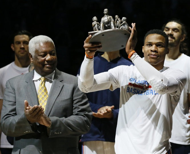 Oklahoma City Thunder guard Russell Westbrook, right, is applauded by Oscar Robertson, on his triple-double record in 2017.