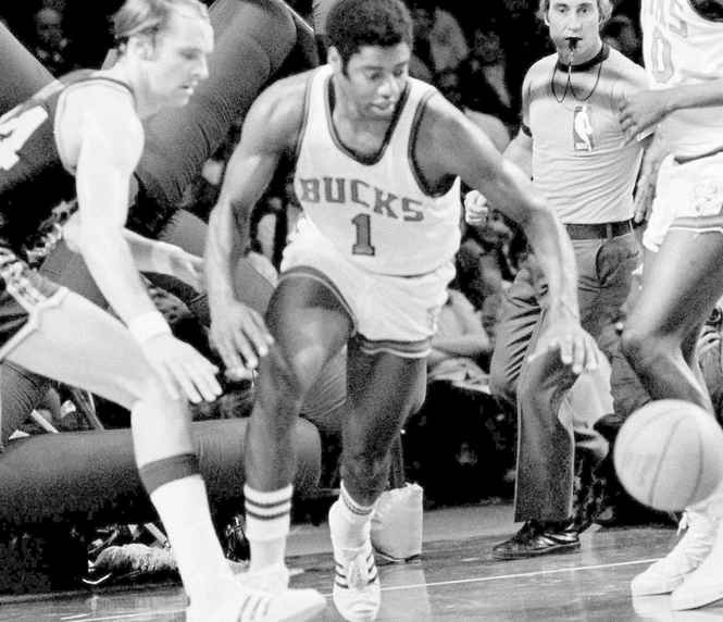 Oscar Robertson (1) of the Milwaukee Bucks steals the ball from Rick Barry, left, of the Golden State Warriors during an NBA playoff game in 1973.