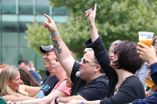 Fans get into the music during the first day of the inaugural InCuya Music Festival. The festival continues Sunday on Malls B and C of downtown Cleveland.