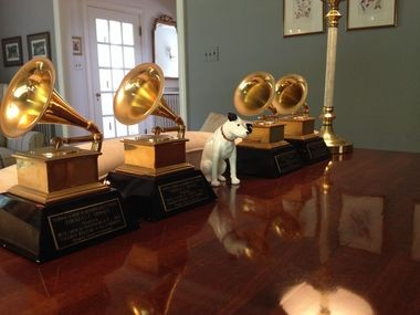 Thomas Moore's four Grammy awards are displayed on a tabletop in his Shaker Heights living room. The awards were given for his audio production recordings.