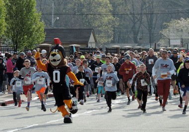 Cleveland Gladiators mascot Rudi leads the pack at the start of Saturday's first-ever Derby Dash 5K in Fairview Park.