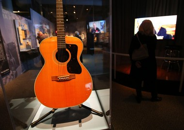 Paul Simon Acoustic guitar, a Guild F-30, 1963, Simon's principal instrument while writing, working and performing during the Simon and Garfunkel years, part of the Paul Simon: Words and Music, at the Rock and Roll Hall of Fame.
