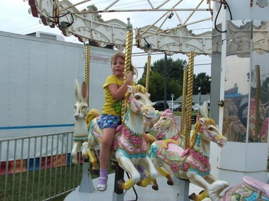 St. Elias Melkite Catholic Church festival. Jackie Au, 3, enjoys merry-go-round in this 2014 photo.