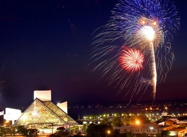 Fireworks explode over Lake Erie next to the Rock and Roll Hall of Fame and Museum.