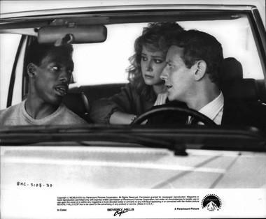 "Eddie Murphy, left, Lisa Eilbacker and Judge Reinhold in a scene in ""Beverly Hills Cop."" The film is being shown at Aut-O-Rama Drive-In Tuesday as part of its Retro Tuesday series."