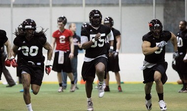 Pierre Woods (55) runs sprints with Cleveland Gladiators teammates Monday during the Arena Football League team's first practice.