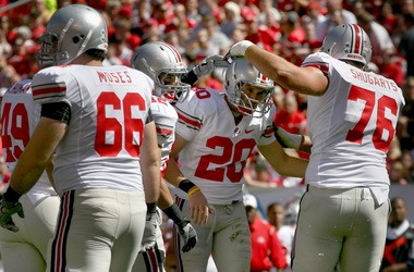 Former Ohio State kicker Aaron Pettrey (20) is congratulated by teammates during a game 2009, the year he led the Big Ten in scoring. He has played a critical role in the 18-1 Cleveland Gladiators' last-minute victories this year, including three-game winning field goals.