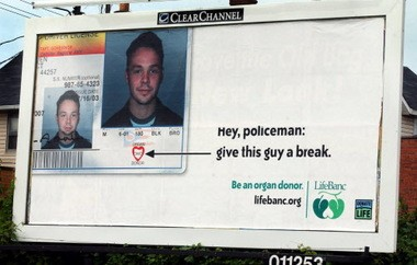A 2004 advertising campaign by LifeBanc to promote organ donation included this billboard, showing the organ donor symbol logo on a driver's license, on Detroit Avenue in Cleveland. A new bill passed by Congress this week paves the way for people with HIV to become organ donors to others with HIV.