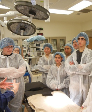 Members of the Pre-Med Club at Beachwood High School visit an operating room at University Hospitals Ahuja Medical Center in March. Starting next fall, students in the school's honors and Advanced Placement track will be able to enroll in the new Medical Academy.