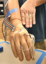 """The prosthetic hand under development at Case and the Cleveland VA can """"feel"""" by sending signals from 20 different spots on the fingers, palm, and back of the hand to the nerves in the arm."""