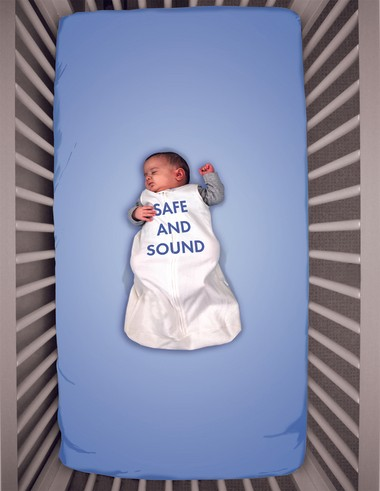 "The caption for this poster, part of the Ohio Department of Public Health's new infant safe sleep campaign, is ""This crib may look empty, but baby is warm and safe here."""