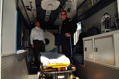 Scott Carlisle, left, and Scott Swickard are inside the ambulance the Cleveland Clinic will use to get help to stroke victims faster. Carlisle works for Excellance Inc., the company that makes the ambulance. Swickard is the Clinic's clinical operations manager for Critical Care Transport.
