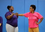 Shawneice Ellis, left, during class in July.