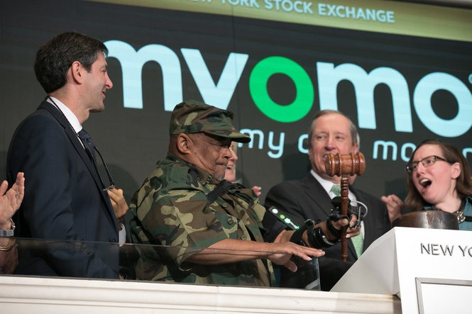 Arthur Johnson of Cleveland, second from left, bangs a gavel to signal the close of trading on the first day that shares of Myomo were traded on the New York Stock Exchange. He did the honors with an assist from his MyoPro brace, while surrounded by Myomo executives. Myomo, a medical robotics company, developed MyoPro and turned to Chardon-based Geauga Rehabilitation Engineering to make custom devices for each patient.