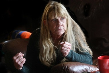 Jean Karchefsky, 63, spends most mornings in her recliner until the pain in her back subsides enough for her to move around.