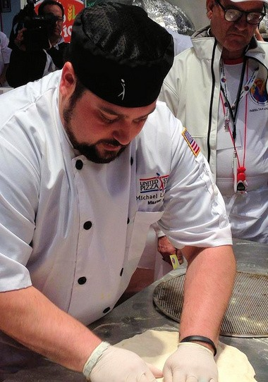 Michael LaMarca prepares a pizza as part of the U.S. Pizza team last year in Italy.