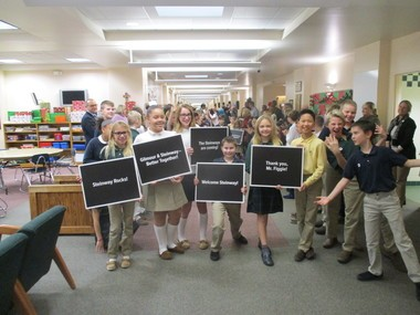 Gilmour Academy lower school students, grades three through six, lined the hallway of the school to show their appreciation Tuesday for Matthew Figgie's gift of 10 Steinway grand pianos to Gilmour's lower, middle and upper schools.
