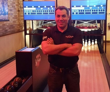 Harry Buffalo General Manager Ray Shelala is ready to serve customers at the establishment's new Wilson Mills Road location in Highland Heights. Here, Shelala is shown in front of Harry Buffalo's duckpin bowling lanes.