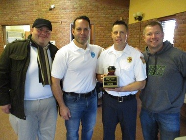 The South Euclid Fire Department won the People's Choice Award at the chili cook-off. From left are Culinary Occasions' Eric Gaizutis and Chef Bob Sferra, Fire Inspector Scott Sebastian, and firefighter Ben Ovelgonne.