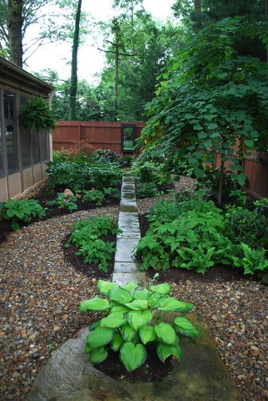 Shady areas where grass doesn't grow well can be dressed up with shade-tolerant plants such as hostas and walkways.