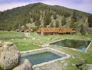 Singer Carole King dropped the price on her Idaho ranch to $9.9 million.