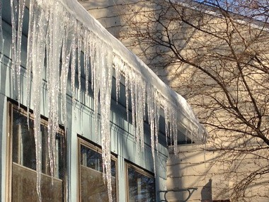 Don't knock large icicles off your gutters, but be aware they may be a sign of ice dams forming.