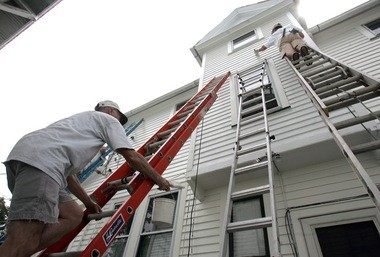 Use both brushes and rollers to paint your home's exterior for best results. (Brynne Shaw/The Plain Dealer)
