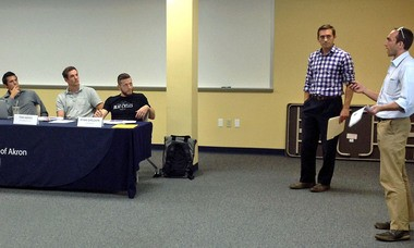 Jeff and Tony Briggs explain to the judges their idea for Burning River Industries.