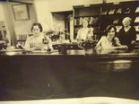 These librarians worked at the Madison Branch Library circulation desk in 1929.