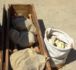 Ballers return the equipment to wooden box for storage after each match (game). Balls are kept in a canvas bag.