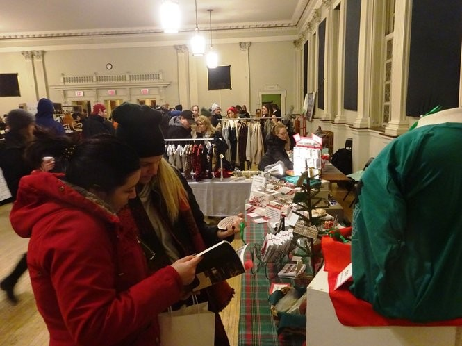 Many people stopped in to peruse the merchandise from local vendors and craftspeople at the new Holiday Market in the Masonic Temple.