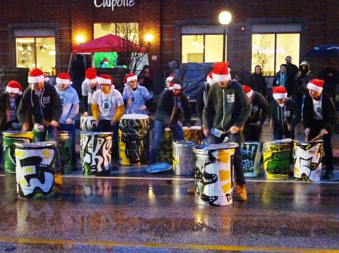 St. Edward High School's Trash Talkers provide entertainment prior to the Light Up Lakewood parade.